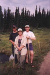 Cheryl, Paul and Garry out in the bush after looking for collapsed and hanging culverts that can prevent fish from migrating up streams in the Kakwa River Watershed.