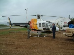Biologist Dave Latham prepares to travel by helicopter to check on the many sites in his research area.  It covers 20,000 square kilometers in northeastern Alberta.