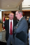 EEDC President Allan Scott confers with U of A's Peter Robertson at TEC Edmonton Launch
