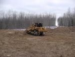 Dozer beginning to level subsoil returned from spoil pile