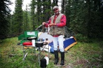 August 20, 2005 - Our camp at Pepper's Lake which is not far off the Forestry Trunk Road south of Nordegg.  Note the rubber boots!  Wayne  (aka Chooch for southerners) stands proudly with the first catch of the day, two very fat brook trout from the chilly waters of Pepper's Lake.